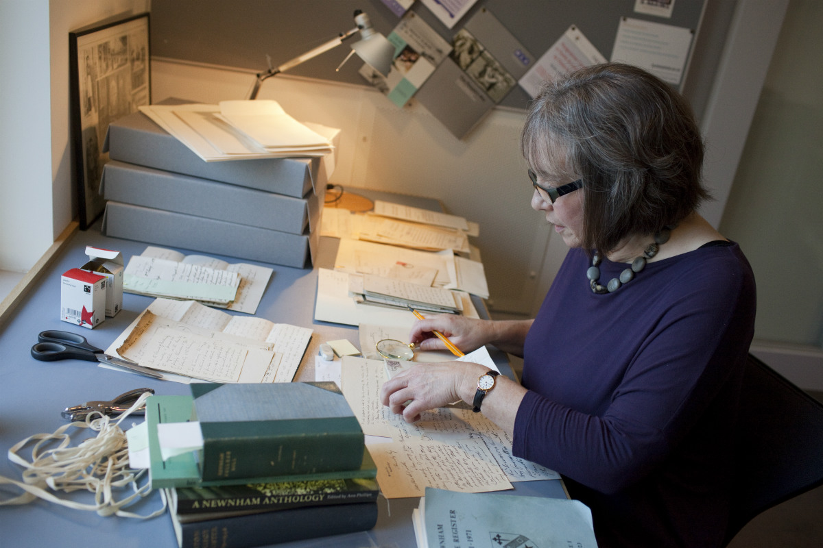 Picture of archivist reading