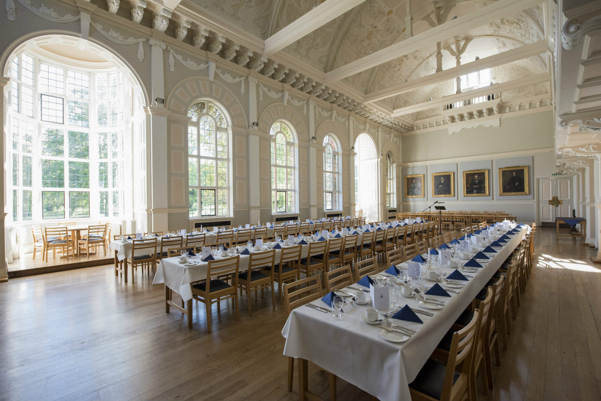 A photo of the College Hall set up for dinner
