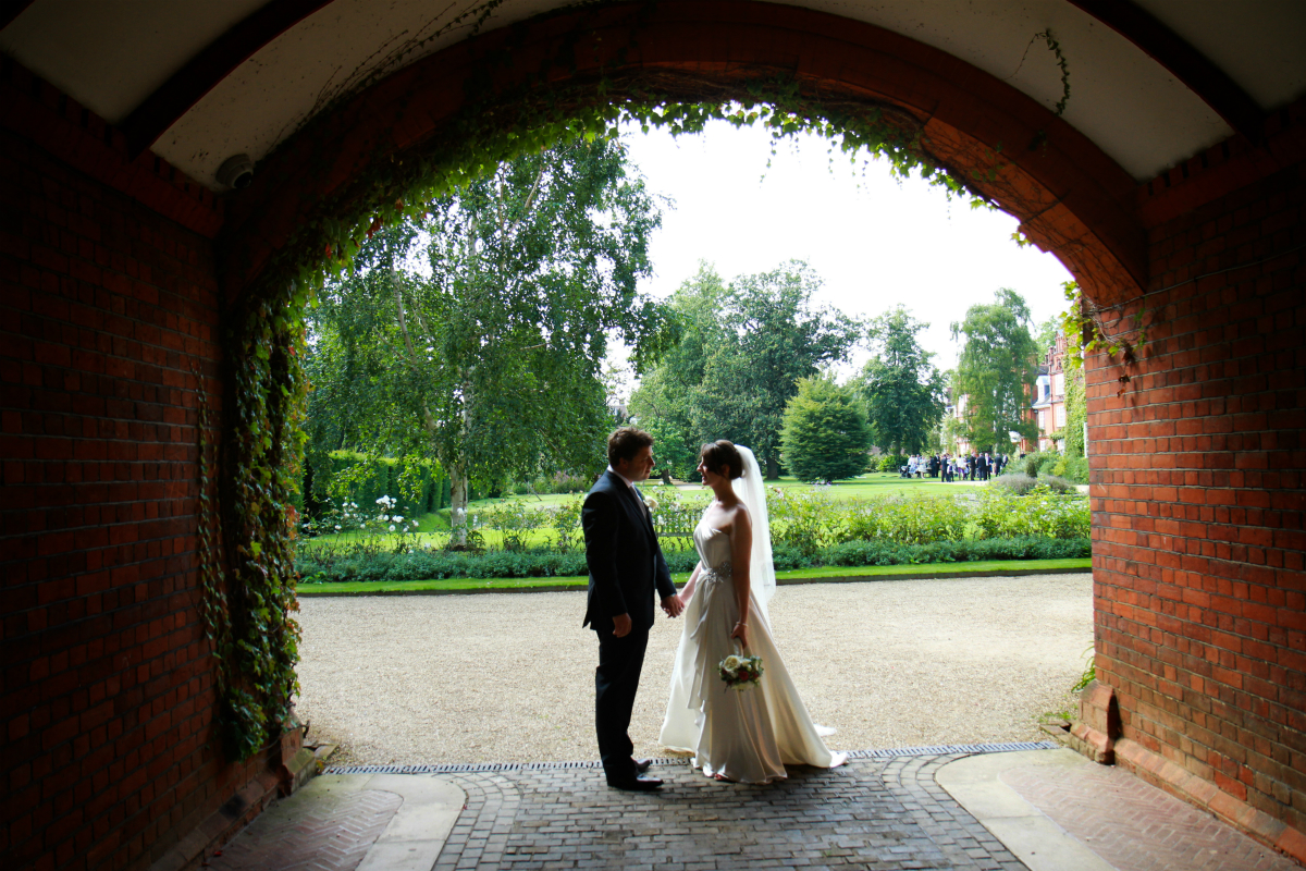 Bride and groom under arch