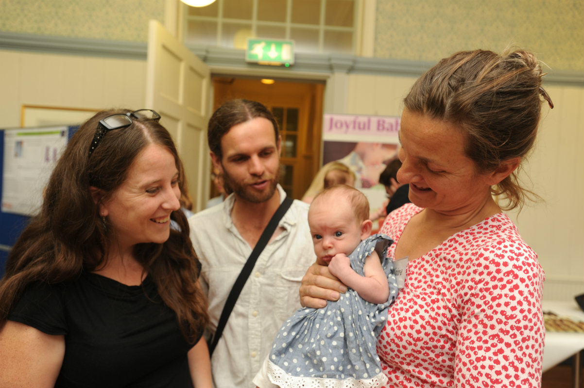 Professor Claire Hughes with parents of new babies for research project