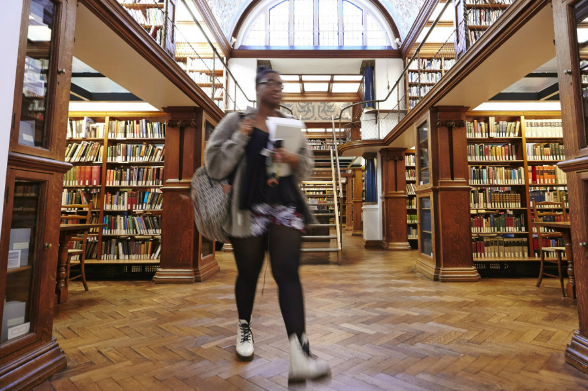 Woman walking through library