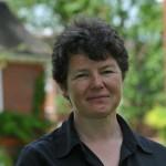 Dr Emma Mawdsley in the gardens at Newnham