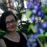 Professor Rae Langton in Newnham's gardens
