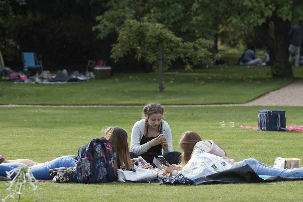 Youngsters relaxing on the lawn